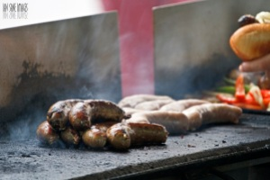 Bratwurst on grill at farmer's market (Ian Sane)